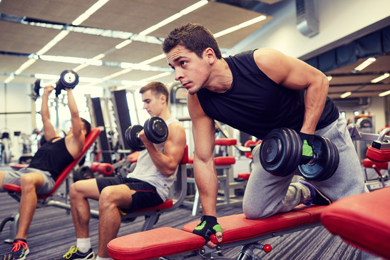 Three Men With Dumbbells In The Gym