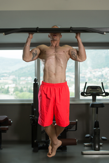 Male Athlete Attempting To Do A Pull-Up