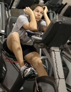 Woman Looking Bored At The Gym