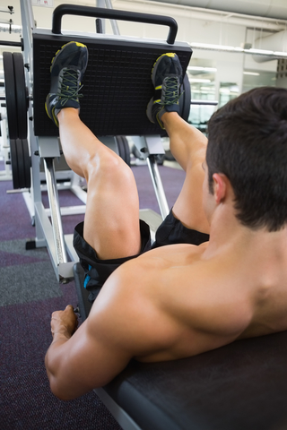 Gym Member Using The Leg Press Machine