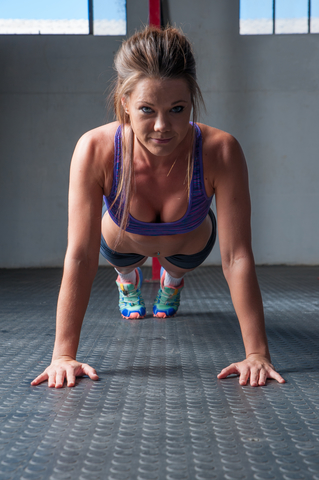 Woman Doing Burpees